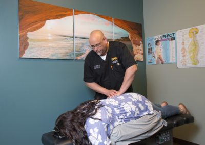 Chiropractor treating pregnant woman.